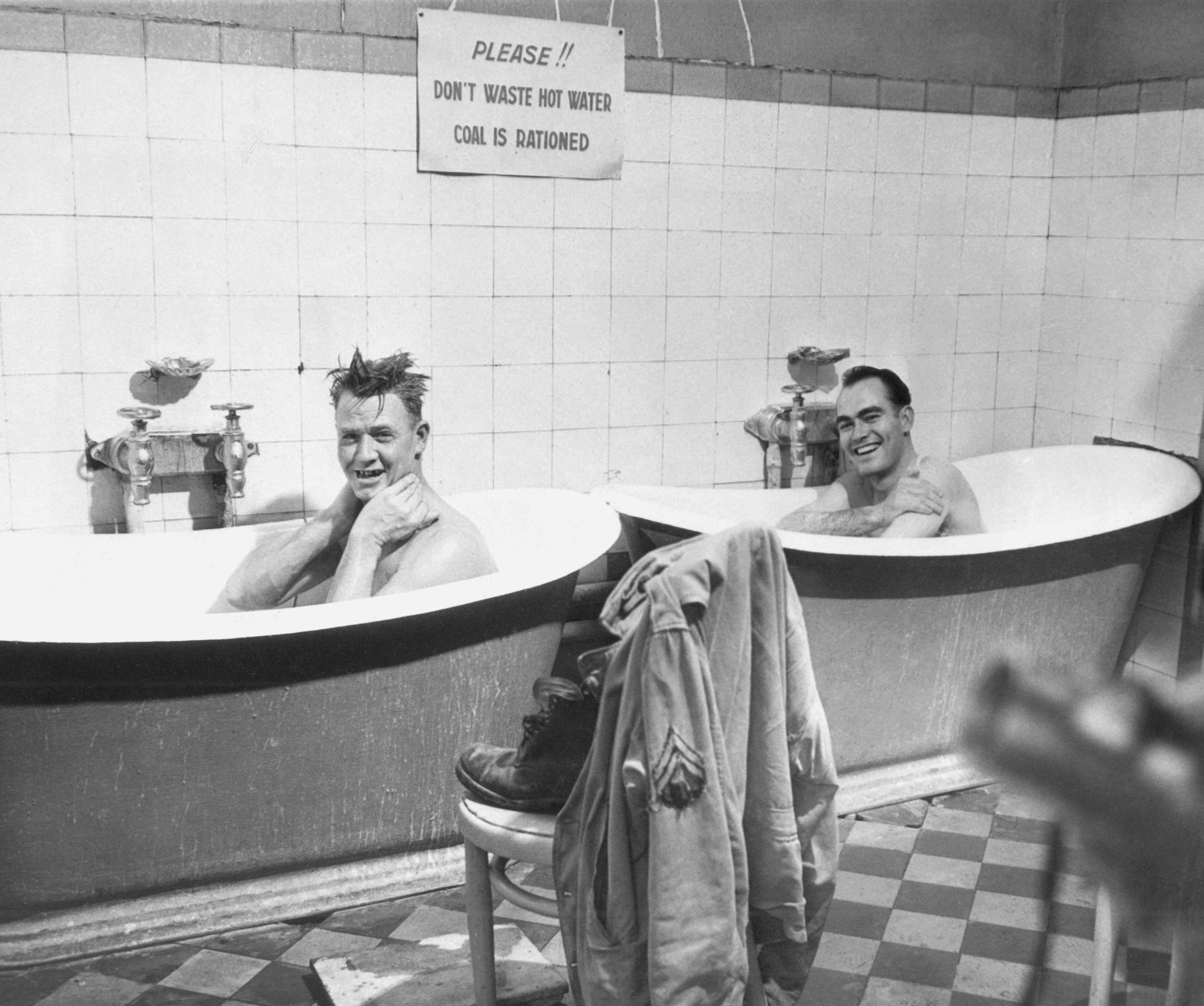 Two American soldiers enjoy the luxury of a hot bath in a French bathhouse at Dijon, now being operated by the Red Cross. From left, Cpl. Manuel Hohenberger and Cpl. George O. Clark.