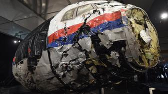 The wrecked cockipt of the Malaysia Airlines flight  MH17 is presented to the press during a presentation of the final report on the cause of the its crash at the Gilze Rijen airbase October 13, 2015. Air crash investigators have concluded that Malaysia Airlines flight MH17 was shot down by a missile fired from rebel-held eastern Ukraine, sources close to the inquiry said today, triggering a swift Russian denial. The findings are likely to exacerbate the tensions between Russia and the West, as ties have strained over the Ukraine conflict and Moscow's entry into the Syrian war.   AFP PHOTO / EMMANUEL DUNAND        (Photo credit should read EMMANUEL DUNAND/AFP/Getty Images)