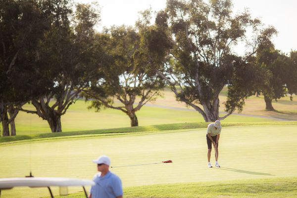 President Obama making a putt at Torrey Pines golf course in San Diego.