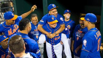 NEW YORK, NY - OCTOBER 12:  Ruben Tejada #11 of the New York Mets receives a piggy back ride from teammate Matt Reynolds #56 before Game 3 of the NLDS against the Los Angeles Dodgers at Citi Field on Monday, October 12, 2015 in the Queens borough of New York City. (Photo by Rob Tringali/MLB Photos via Getty Images) *** Local Caption)