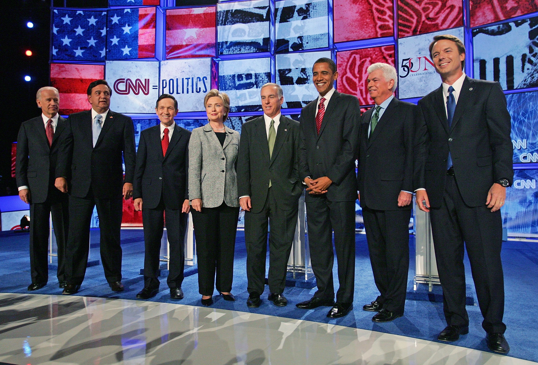 LAS VEGAS - NOVEMBER 15:  (L-R) U.S. Sen. Joe Biden (D-DE), New Mexico Gov. Bill Richardson, U.S. Rep. Dennis Kucinich (D-OH), U.S. Sen. Hillary Clinton (D-NY), Democratic National Committee Chairman Howard Dean, U.S. Sen. Barack Obama (D-IL), U.S. Sen. Chris Dodd (D-CT), and former U.S. Sen. John Edwards (D-NC), are introduced during a Democratic presidential debate at UNLV sponsored by CNN November 15, 2007 in Las Vegas, Nevada.  (Photo by Ethan Miller/Getty Images)