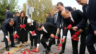 ANKARA, TURKEY - OCTOBER 13: Turkish Prime Minister Ahmet Davutoglu (R-4), his wife Sare Davutoglu (L-3), deputy Prime Ministers Cevdet Yilmaz (R), Yalcin Akdogan (R-2) and Justice and Development Part Deputy Chairman Omer Celik (R-3) lay red carnations at the site of twin bombings near Ankara train station on October 13, 2015 in Ankara, Turkey. Two suicide bombers, using five kilograms of TNT explosives each, carried out Saturday's twin bomb blasts in Ankara that killed at least 97 people, Turkish Deputy Prime Minister Numan Kurtulmus said late Monday. (Photo by Hakan Goktepe/Anadolu Agency/Getty Images)