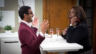 PARKS AND RECREATION -- 'One Last Ride' Episode 712/713 -- Pictured: (l-r) Aziz Ansari as Tom Haverford, Retta as Donna Meagle -- (Photo by: Paul Drinkwater/NBC/NBCU Photo Bank via Getty Images)