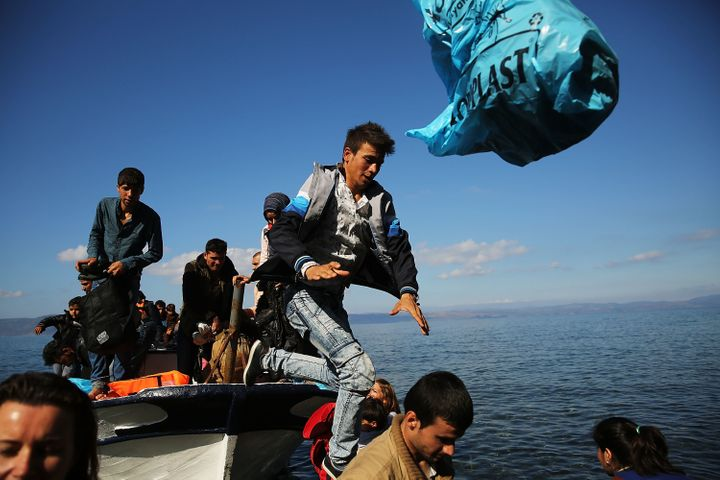 Syrian and Iraqi refugees arrive on the island of Lesbos, in Greece, on Oct. 13, 2015. Spain hasn't sold weapons to Syria sin