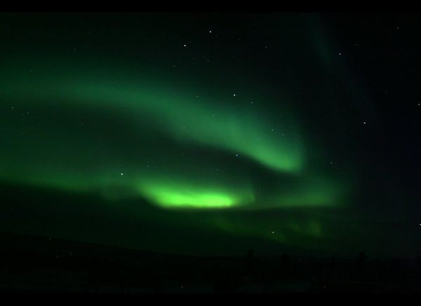 An aurora with arcs in different shades of green <br><br><strong>Why Go</strong>: The British isles are known for stormy, fog