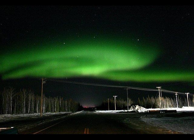 "Northern Lights and stars in Alaska <br><br><strong>Why Go</strong>: Alaska's location within ""the zone"" means you're almost"