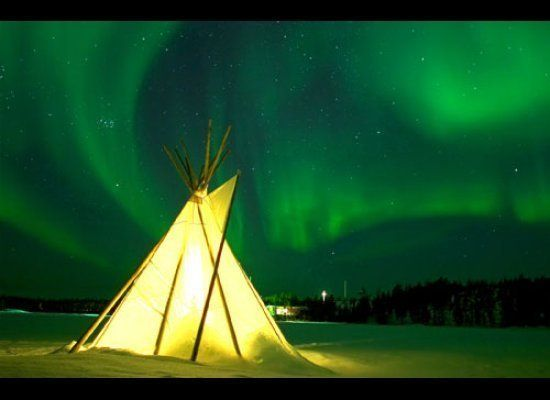 Northern Lights and illuminated Teepee in Yellowknife, Northwest Territories<br><strong><br>Why Go</strong>: Areas around pri
