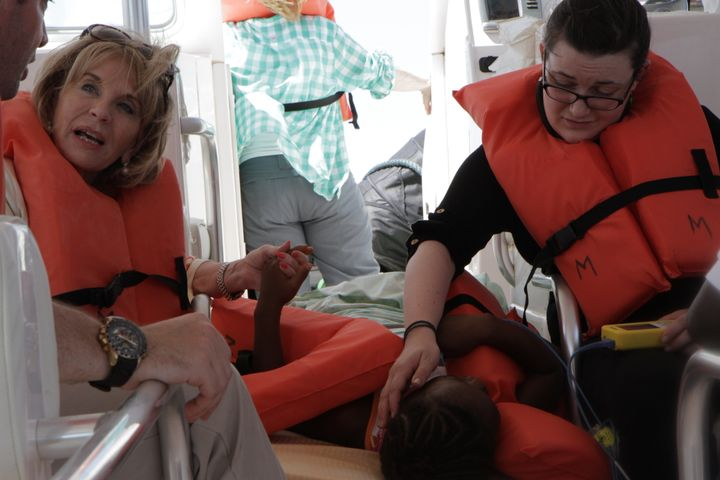 Ann Gloag, pictured on a boat transferring a patient to a new hospital.