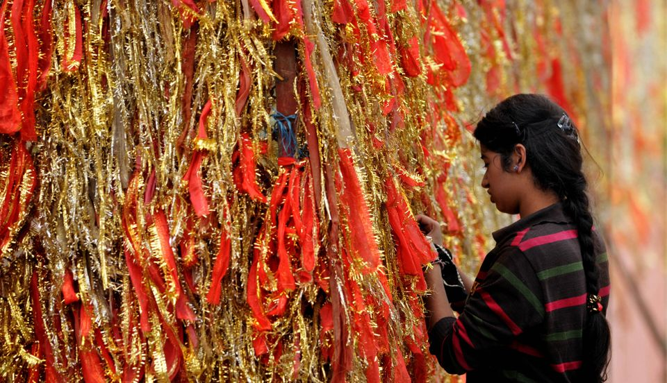JAMMU, INDIA - OCTOBER 13: A devotees ties a Chunnari (religious cloth) on the first day of Navratras at Babe Wali mata (Bahu