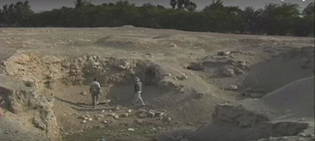 Researchers walk along the site of Tal el-Hammam.