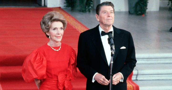 First lady Nancy Reagan and President Ronald Reagan greet the press outside the White House in May 1981.
