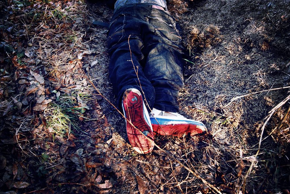 "<span class='image-component__caption' itemprop=""caption"">Robert Chambers' body lies on the ground after he was shot and killed by a police officer.</span>"