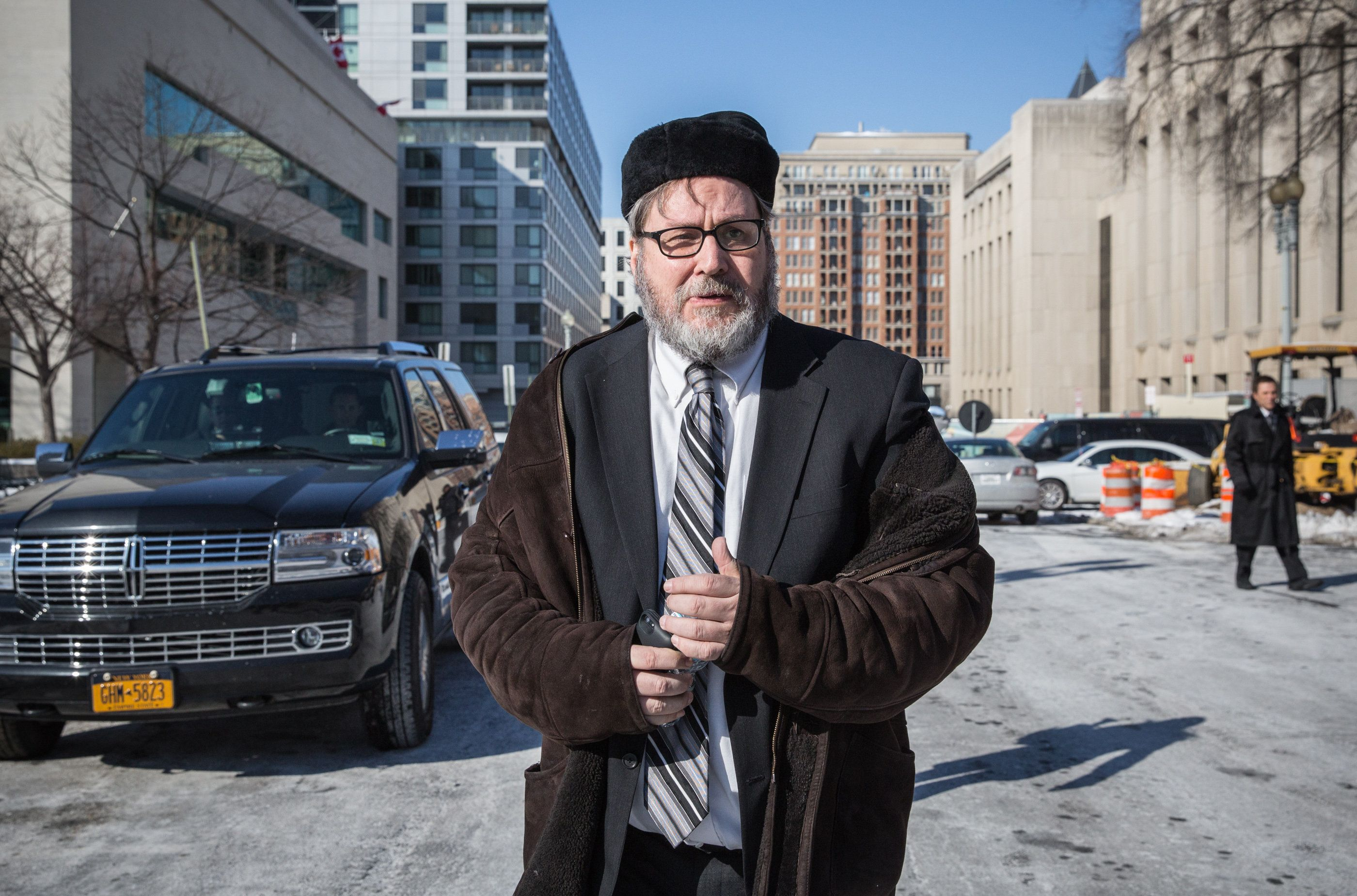 WASHINGTON,DC - FEB19: Rabbi Barry Freundel leaves the District Superior courthouse after his hearing was postponed until the afternoon, February 19, 2015 in Washington, DC. The former spiritual leader at Kesher Israel Congregation in Georgetown who is charged with six counts of misdemeanor voyeurism for allegedly videotaping women as they undressed in preparation to use the mikvah at The National Capital Mikvah. (Photo by Evelyn Hockstein/For The Washington Post via Getty Images)