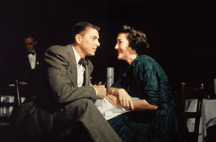 Ronald and Nancy Reagan gaze at one another across a table in 1952, the year they married in Los Angeles.