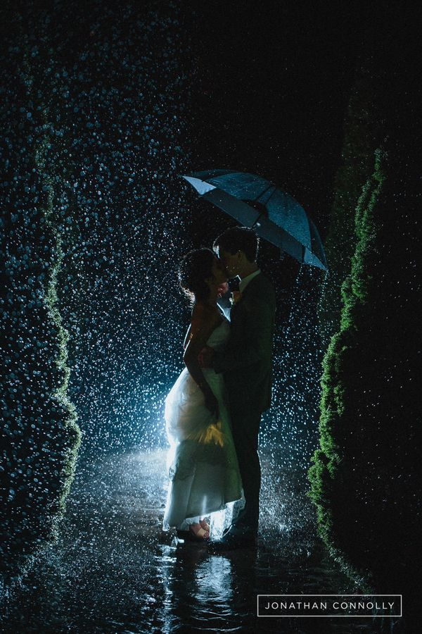 """""""During the reception, the bride and groom decided to sneak away for some photos in the rain. Sometimes the more challenging"""
