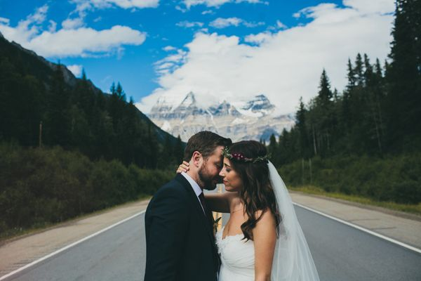 """""""Ilove how the trees, road and Canadian Rockies created a beautiful backdrop and focal point for this rad couple."""" - <i"""