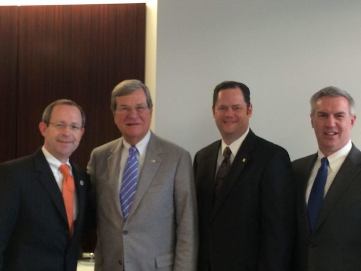 Pictured, left to right: Brad Beacham, executive director of Sigma Nu; former Sen. Trent Lott (R-Miss.); Larry Stan