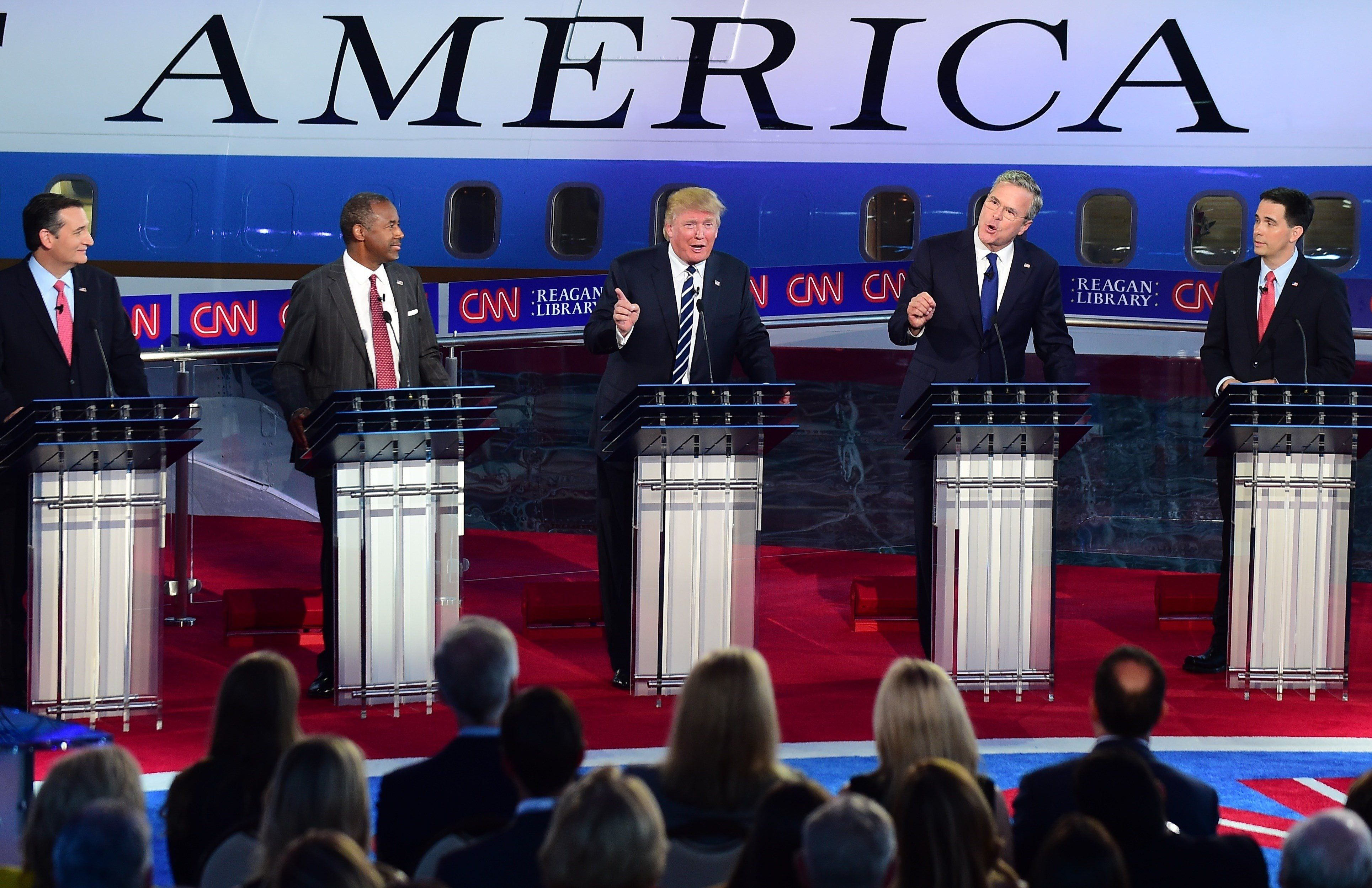 Republican presidential hopefuls, (L-R) Texas Sen. Ted Cruz, retired neurosurgeon Ben Carson, real estate magnate Donald Trump, former Florida Gov. Jeb Bush and Wisconsin Gov. Scott Walker participate in the Republican presidential debate at the Ronald Reagan Presidential Library in Simi Valley, California on September 16, 2015.  Republican presidential frontrunner Donald Trump stepped into a campaign hornet's nest as his rivals collectively turned their sights on the billionaire in the party's second debate of the 2016 presidential race.  AFP PHOTO / FREDERIC J. BROWN        (Photo credit should read FREDERIC J BROWN/AFP/Getty Images)