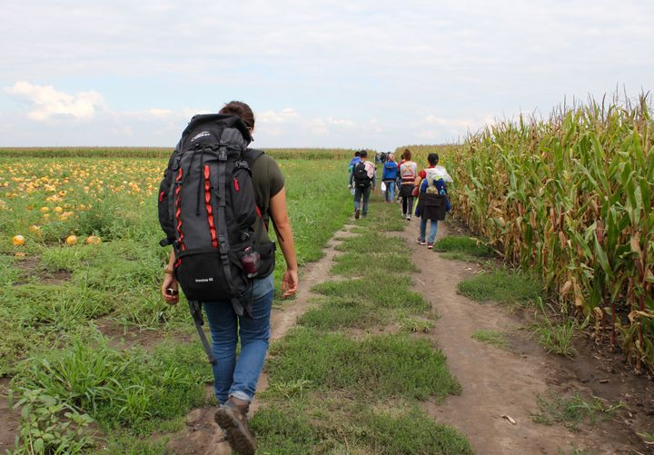 Hiba Dlewati walks with a group of Syrian men, women and children from war-torn Kobani as they trek to the Serbia-Hungary bor