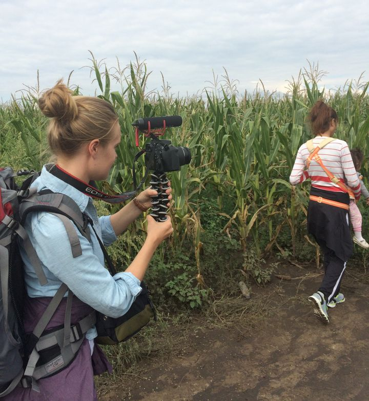 Sophia Jones filming on the Serbia-Hungary border, a few hours before the group of Syrian refugees from Kobani she traveled w