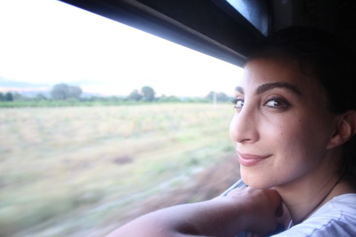 Hiba looks out of the window on a train carrying thousands of refugees from Macedonia's border with Greece toward Serbia. Rio