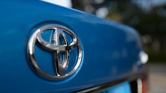 The Toyota Motor Corp. logo is displayed on a Crown vehicle during a test drive in Tokyo, Japan, on Tuesday, Oct. 6, 2015. The Crown sedan will be the first of three Toyota models going on sale in Japan this year that can deliver audio and visual alerts when a driver has taken his or her foot off the brake and has started to creep into an intersection. Photographer: Akio Kon/Bloomberg via Getty Images