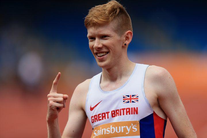 Bosworth celebrates winning the men's 5000m race walk with a new British record atthe Sainsbury's British Championships