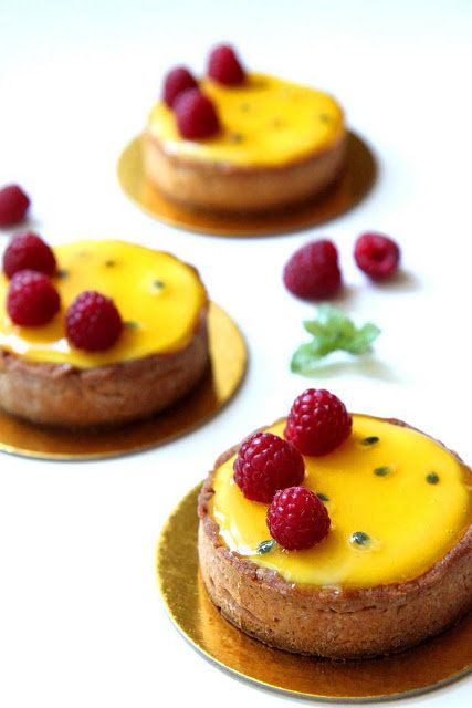 "<strong>Get the <a href=""http://gourmetbaking.blogspot.com/2012/05/passion-fruit-and-raspberry-tart.html"" target=""_blank"">Pas"