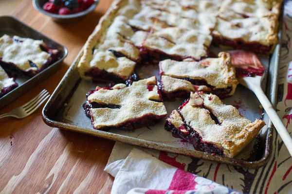 "<strong>Get the <a href=""http://whiteonricecouple.com/recipes/berry-slab-pie/"" target=""_blank"">Mixed Berry Slab Pie with Choc"