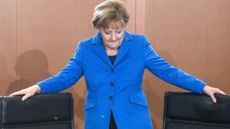German Chancellor Angela Merkel arrives for a weekly meeting of the German cabinet at the Chancellery in Berlin on October 14, 2015. AFP PHOTO / JOHN MACDOUGALL        (Photo credit should read JOHN MACDOUGALL/AFP/Getty Images)