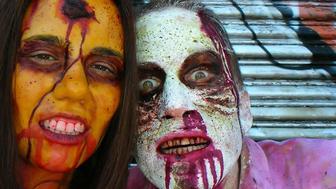 Couple dressed like zombies