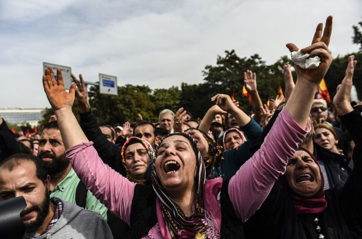 People express their grief as they gather in Ankara a day after the city was struck by deadly twin bomb attacks.