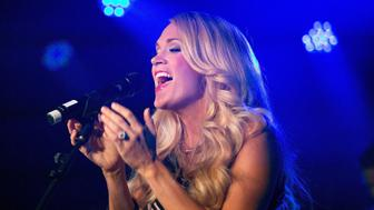 LONDON, ENGLAND - SEPTEMBER 22:  Carrie Underwood performs an acoustic set on stage at her album launch of 'Storyteller' at The Basement at The London Edition Hotel on September 22, 2015 in London, England.  (Photo by Jo Hale/Redferns)