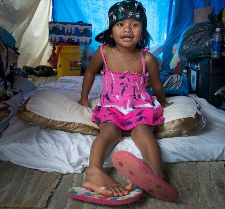 Emichan in her family's tent in Honolulu.