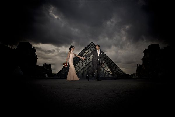 """""""The Louvre was the backdrop -- and as per usual, packed with visitors. We had less than 5 minutes to get this photo given th"""