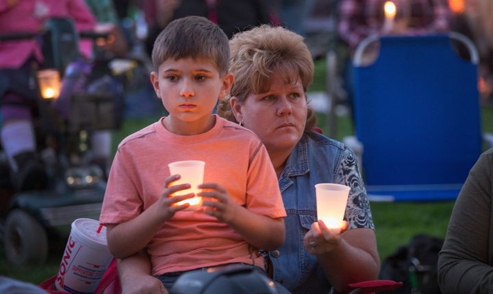 Mourners at a vigil for the victims of the October 1 Umpqua Community College massacre. The mass shooting in Roseburg, Oregon