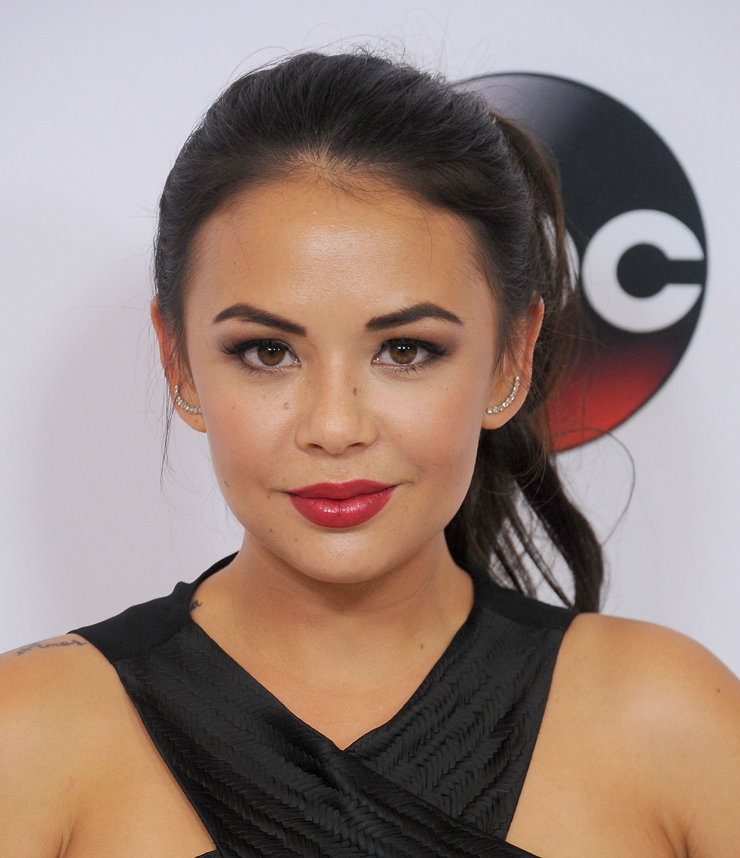 BEVERLY HILLS, CA - AUGUST 04:  Actress Janel Parrish arrives at the Disney ABC Television Group's 2015 TCA Summer Press Tour on August 4, 2015 in Beverly Hills, California.  (Photo by Gregg DeGuire/WireImage)