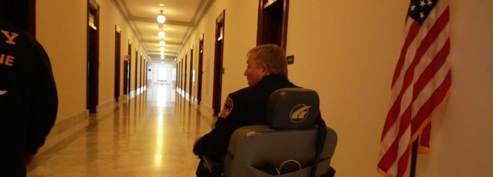 Ray Pfeifer rolls through the halls of the Russell Senate Office Building.