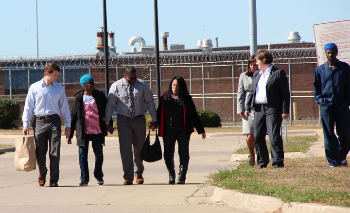 Shawn Whirl, center, is flanked by family, friends and attorneys, exists the Hill Correctional Center in Galesburg, Illinois