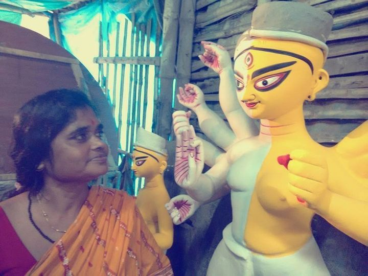 Artist China Pal created the unique Ardhanarishvara Durga idol for the puja.