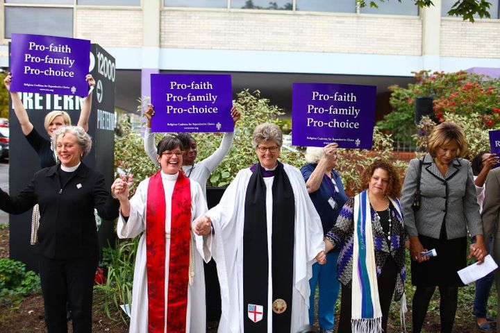 From left to right: Rev. Dr. Shawnthea Monroe, Rev. Laura Young, Rev. Tracey Lind, Rabbi Allison Vann, Rev. Dr. Susan K. Smit
