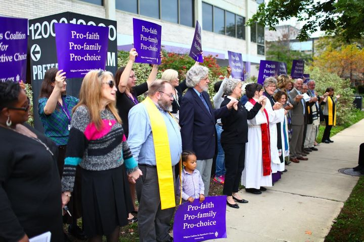 Clergy members and others stand outside the Preterm abortion clinic in support of the pro-choice movement.