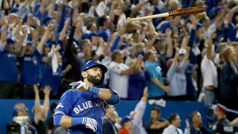 TORONTO, ON - OCTOBER 14:  Jose Bautista #19 of the Toronto Blue Jays throws his bat up in the air after he hits a three-run home run in the seventh inning against the Texas Rangers in game five of the American League Division Series at Rogers Centre on October 14, 2015 in Toronto, Canada.  (Photo by Tom Szczerbowski/Getty Images)
