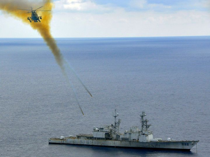 A Mexican helicopter fires explosive rockets at the ex-USS Conolly during a sinking exercise in 2009.