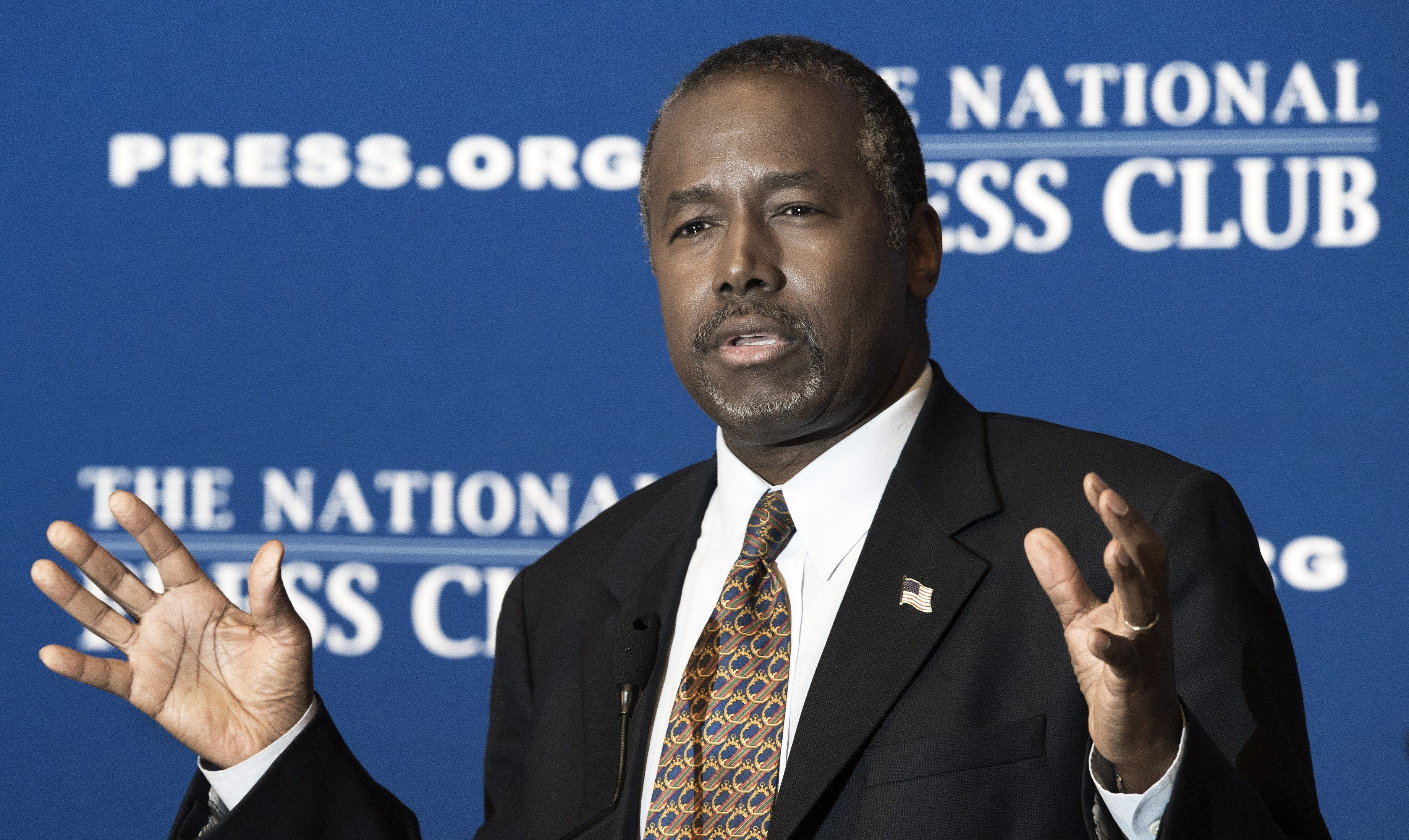 Republican presidential candidate Ben Carson gestures as he discuss his new book 'A More Perfect Union: What We the People Can Do To Reclaim Our Constitutional Liberties' at the National Press Club in Washington, DC on October 9, 2015. Republican White House hopeful Ben Carson said he stood by controversial comments linking gun control to the Holocaust, as he argued for arming staff in schools to prevent future mass shootings.     AFP Photo/PAUL J. RICHARDS        (Photo credit should read PAUL J. RICHARDS/AFP/Getty Images)