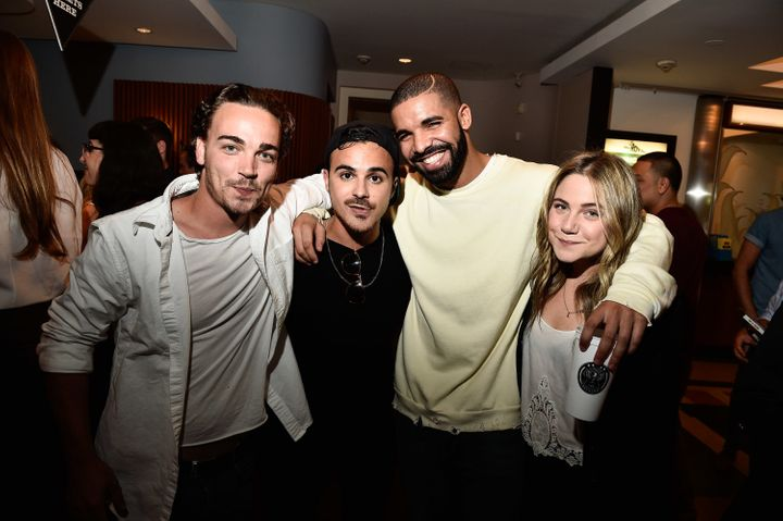 Drake (3rd from L) poses with his former 'Degrassi' co-stars Daniel Clark, Adamo Ruggiero and Lauren Collins