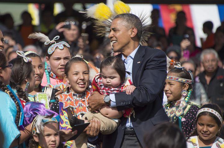 President Barack Obama greets Native American children in Cannon Ball, North Dakota, on June 13, 2014. The U.S. Department of