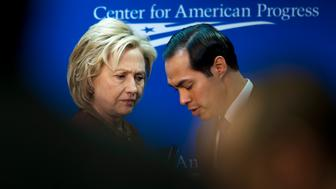 Hillary Clinton, former U.S. secretary of state, left, and Julian Castro, U.S. housing and urban development secretary, prepare to depart after an event at the Center for American Progress in Washington, D.C., U.S., on Monday, March 23, 2015. A lot of U.S. cities have 'inequality that has only gotten worse,' Clinton said during an event on expanding opportunity in U.S. urban areas. Photographer: Pete Marovich/Bloomberg via Getty Images