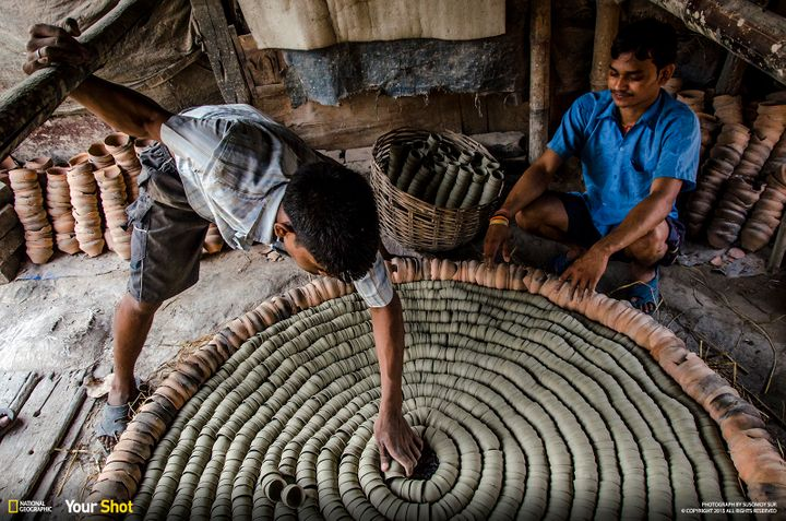 """In """"<a href=""""http://yourshot.nationalgeographic.com/profile/369687/"""">Soil</a>,"""" men arrange clay cups to form disposable chai"""