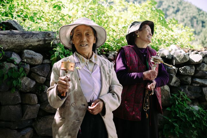 A woman spins a prayer wheel in Wenping village.